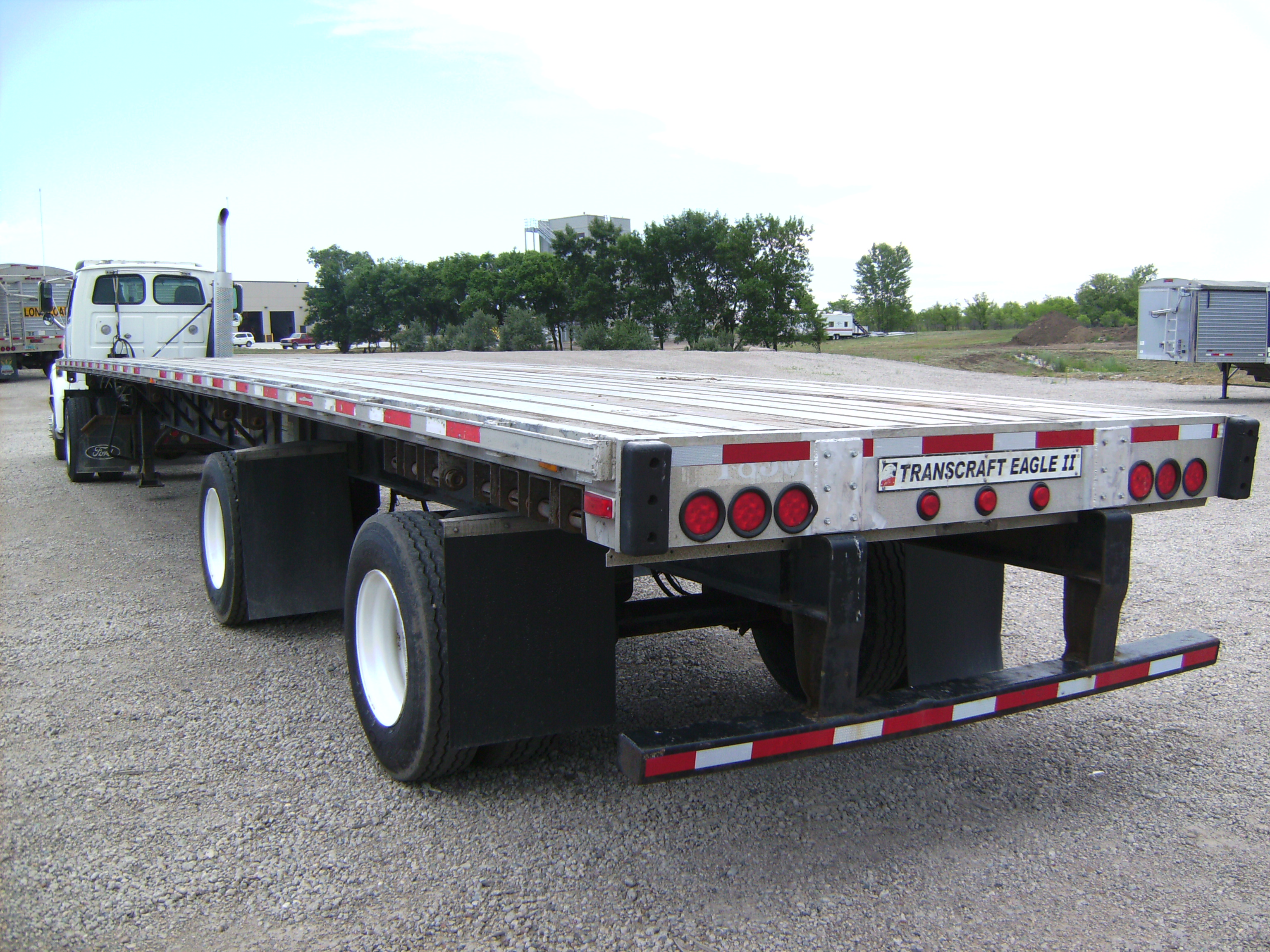 http://www.semitrailersalesandleasing.com/image/cache/2005_Transcraft_48x102_flatbed_012740_005.JPG Image